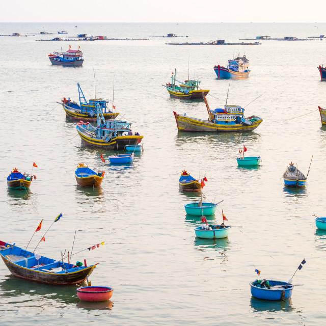 """Fishing boats in harbor at Mui Ne, Phan Thiet, Binh Thuan Province, Vietnam"" stock image"