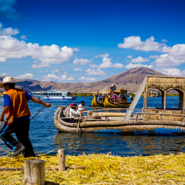 """Quechua Indian Family on Floating Grass islands of Uros, Lake Titicaca, Peru"" stock image"