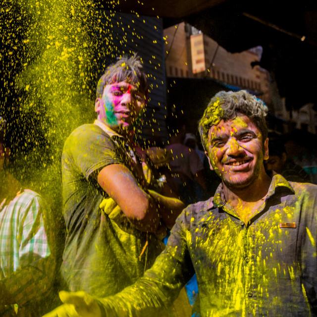 """Men throwing yellow pigment, Holi Festival, Vrindavan, India"" stock image"