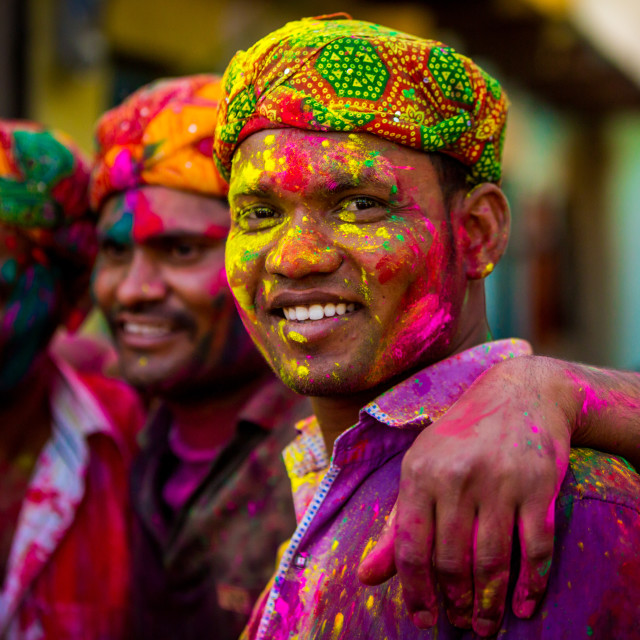 """Men throwing colored pigment, Holi Festival, Vrindavan, India"" stock image"