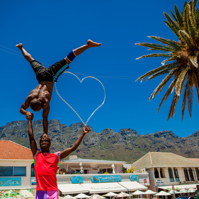 """African Acrobats, Camps Bay, South Africa"" stock image"