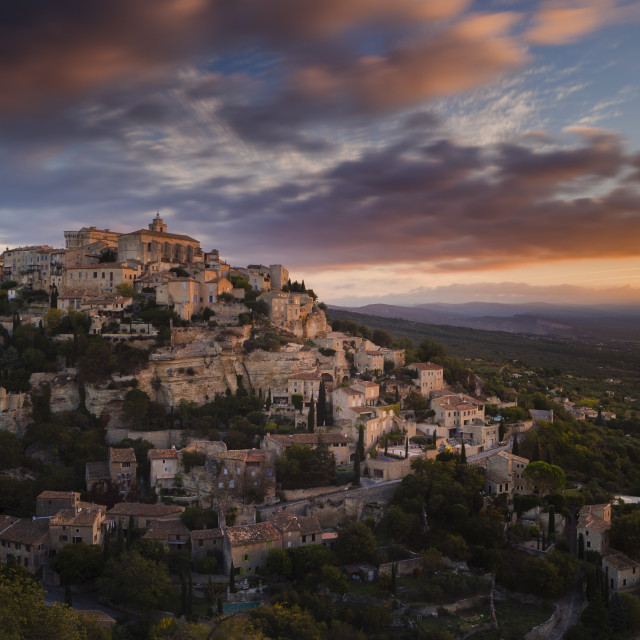 """""""Dawn light illuminates the houses and buildings of Gordes as they spiral up..."""" stock image"""
