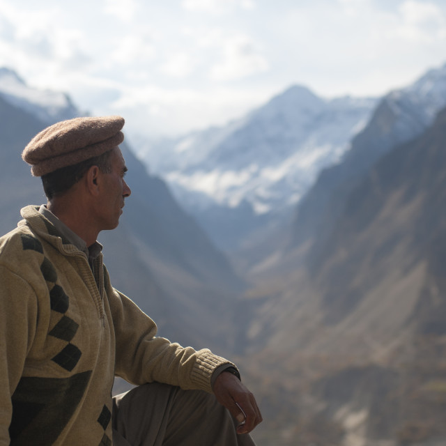 """""""A man looks out over the Hunza valley in Pakistan"""" stock image"""