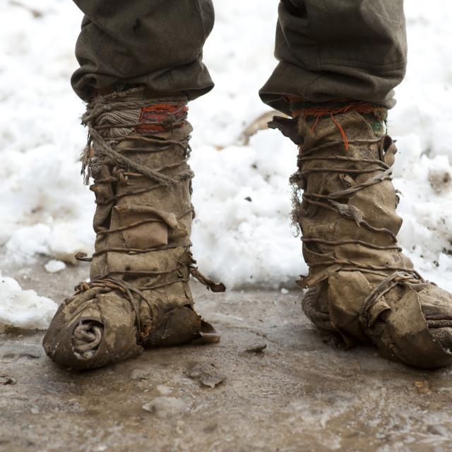 """A Kalasha shepherd wears boots made from goat skin in Pakistan"" stock image"