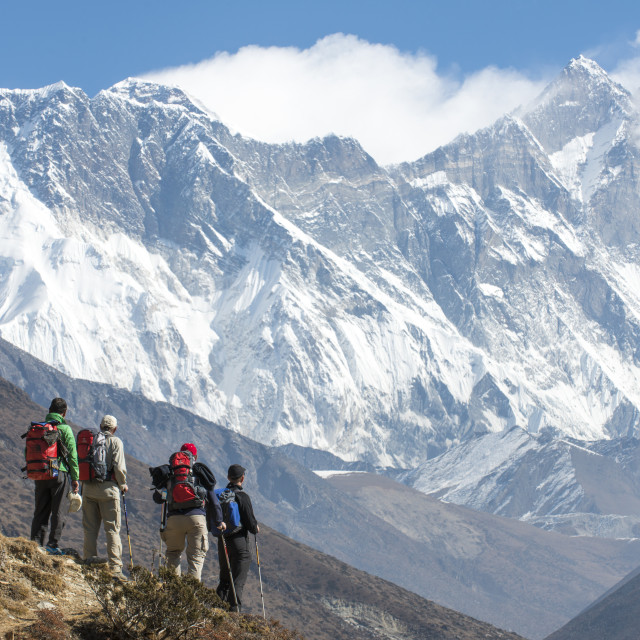 """""""Trekkers look up at Everest, the distant peak on the left), with Nuptse and..."""" stock image"""