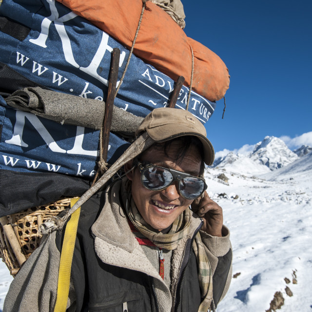 """""""A Sherpa near Dingboche hauling gear to Everest base camp for the climbing..."""" stock image"""
