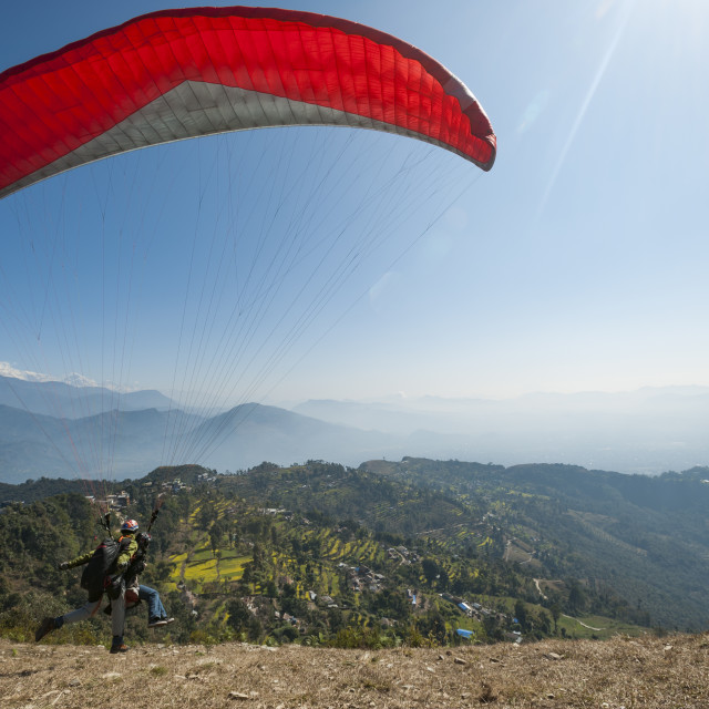 """A tandem paraglider takes to the air from the top of Sarankot near Pokhara in..."" stock image"