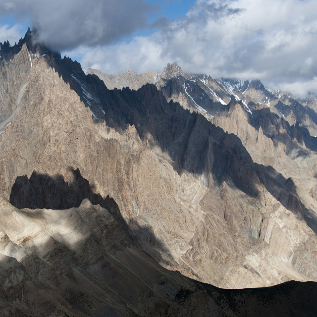 """Light and shadow move across the jagged peaks of the Zanskar range seen here..."" stock image"