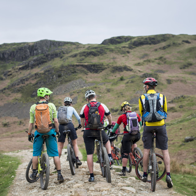 """Mountain bikers stop to consider their route around Loughrigg fell in the..."" stock image"