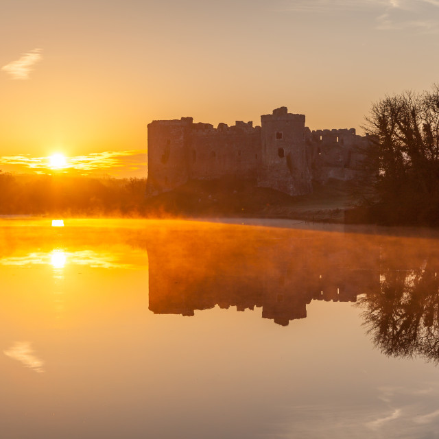 """Carew Castle sunrise, Pembrokeshire, Wales, United Kingdom, Europe"" stock image"