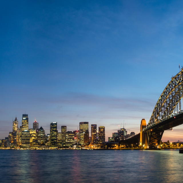 """Sydney's iconic buildings are lit up as dusk settles over the city."" stock image"