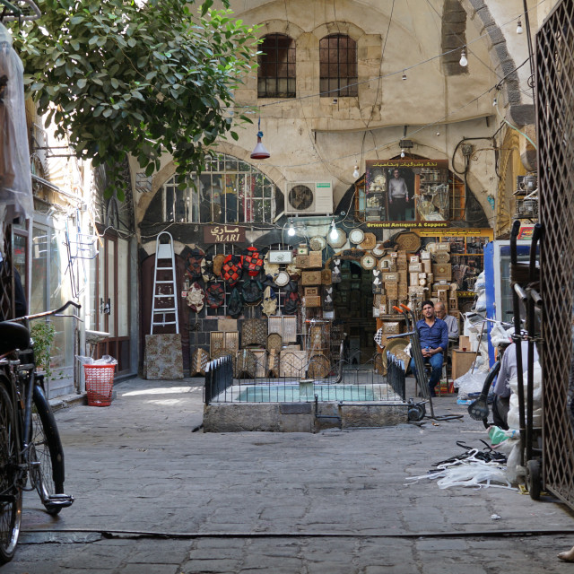 """A local souk vendor waits for his next customer, Damascus, Syria"" stock image"