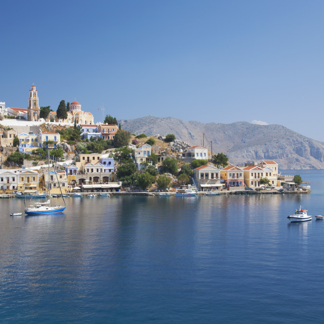 """""""View across the tranquil waters of Harani Bay, Gialos (Yialos), Symi (Simi),..."""" stock image"""
