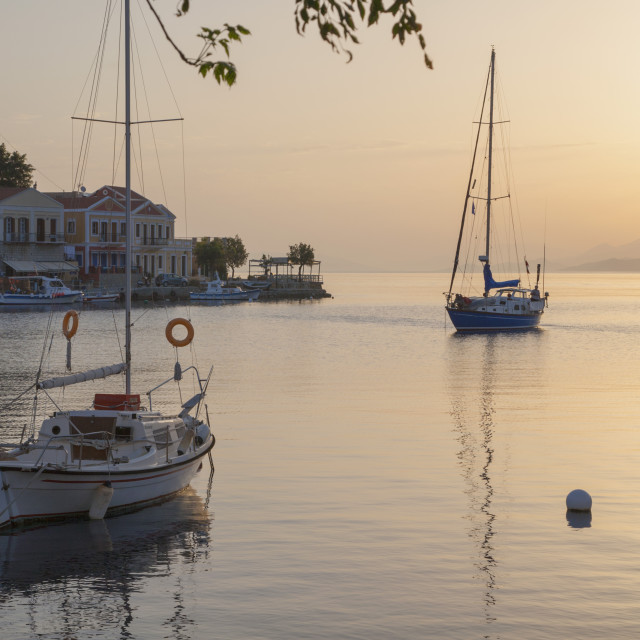 """""""View across the tranquil harbour, sunrise, Gialos (Yialos), Symi (Simi),..."""" stock image"""