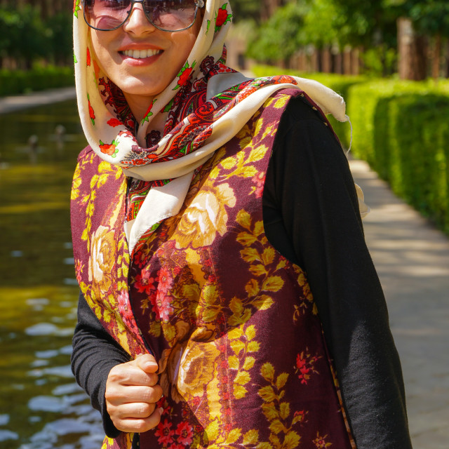 """Young Iranian woman in fashionable modern clothes, Bagh-e Dolat garden, Yazd,..."" stock image"