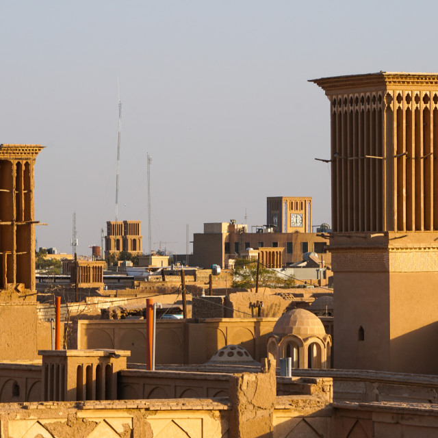 """Citscape at dusk with many windtowers (badgirs), Yazd, Iran"" stock image"