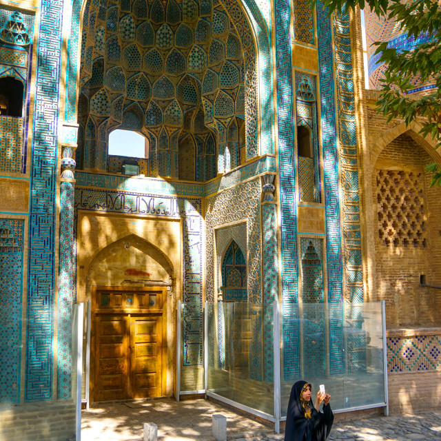 """Young Iranian girl in chador taking picture in front of Jameh Mosque, Natanz,..."" stock image"