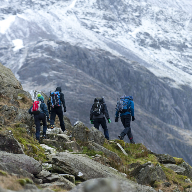 """""""Hikers set off from Pen Y Pass in winter to climb Mount Snowdon in Snowdonia..."""" stock image"""