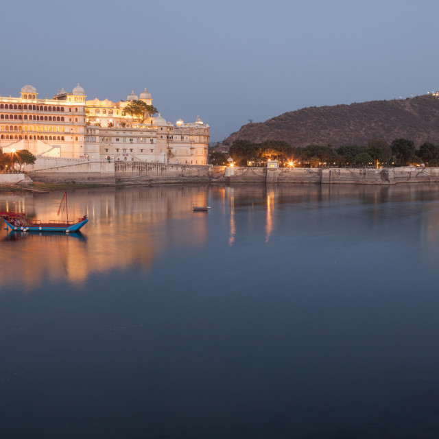 """City Palace in Udaipur at night, reflected in Lake Pichola"" stock image"