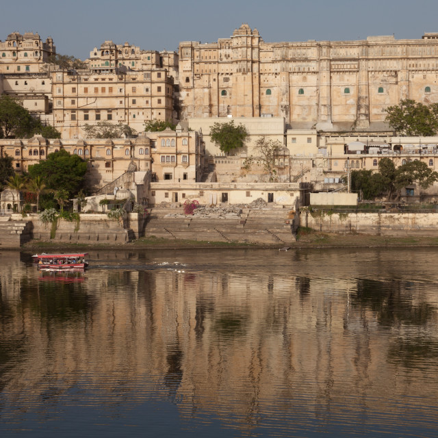 """City Palace Museum in Udaipur seen from Lake Pichola"" stock image"