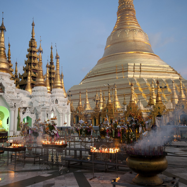 """""""Lit candles placed by devotees at sunset at the Shwesagon Pagoda, a 2,500..."""" stock image"""