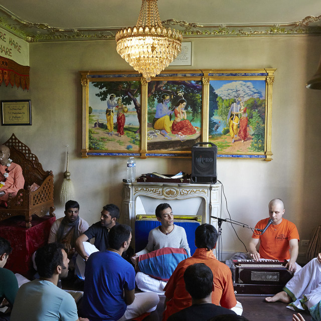 """Devotees chanting kirtans in the Sarcelles ISKCON temple."" stock image"