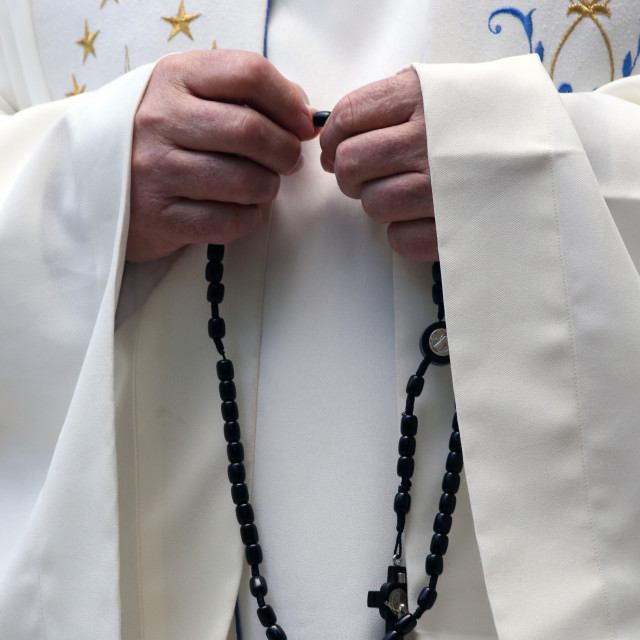 """Hand-carved Roman Catholic rosary beads. Priest praying The Mystery of the..."" stock image"