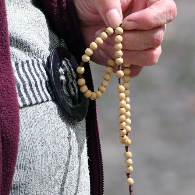 """Hand-carved Roman Catholic rosary beads. Woman praying The Mystery of the..."" stock image"
