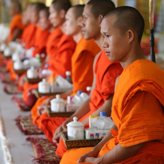 """Wat Ong Teu buddhist temple. Seated Buddhist monks chanting and reading..."" stock image"