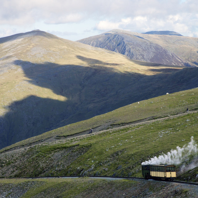 """Steam engine and passenger carriage on trip down Snowdon Mountain Railway,..."" stock image"