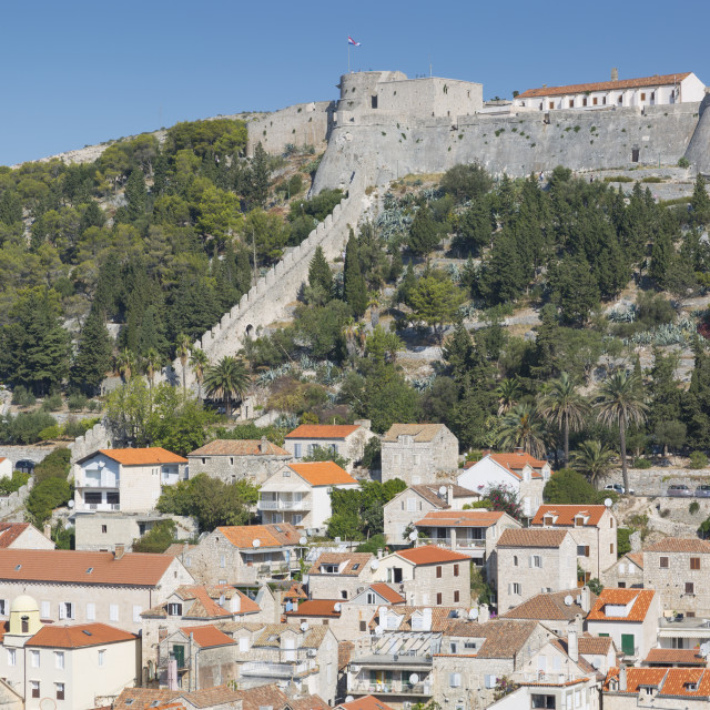 """""""View of Hvar Main Square overlooked by Spanish Fortress, Hvar Island,..."""" stock image"""