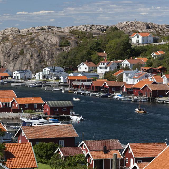 """Fishermen's houses and summer houses along coastline, Hamburgsund, Bohuslan..."" stock image"