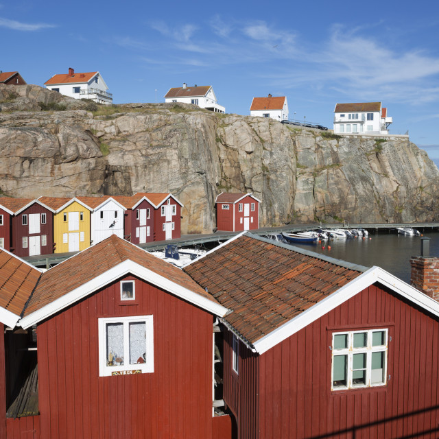 """Traditional falu red fishermen's houses in harbour, Smogen, Bohuslan Coast,..."" stock image"