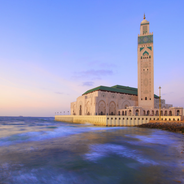 """Exterior of Hassan ll Mosque and coastline at dusk, Casablanca, Morocco,..."" stock image"