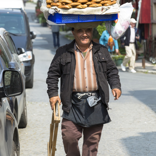 """Typical Simitci Turkish man selling simit, Turkish sesame bread rings, in..."" stock image"