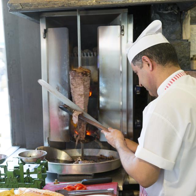 """Chef at Ciya Sofrasi Turkish restaurant slicing lamb doner kebab in Kadikoy..."" stock image"
