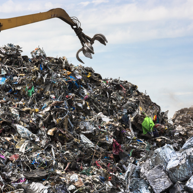 """Grab machine organising metal recycling of scrap metal to avoid environmental..."" stock image"