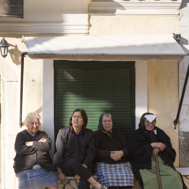 """""""Elderly Corfiot women wearing traditional black clothes sitting relaxing in..."""" stock image"""