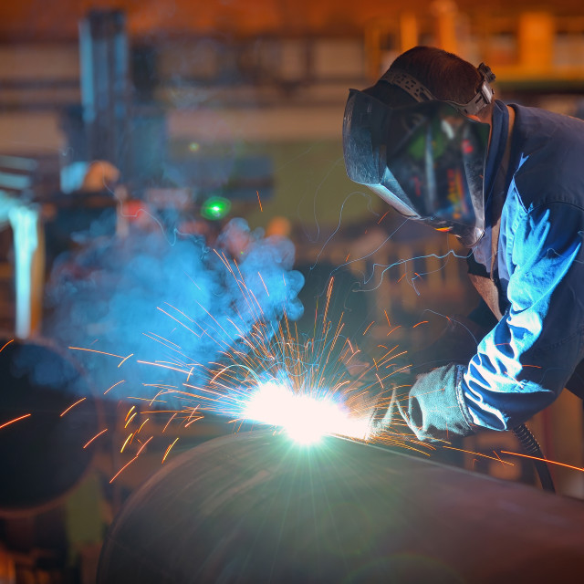 """Welder performs welding large diameter pipe"" stock image"