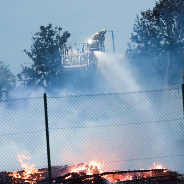 """Large fire destroys large derelict building at Chaford Hundreds,"" stock image"