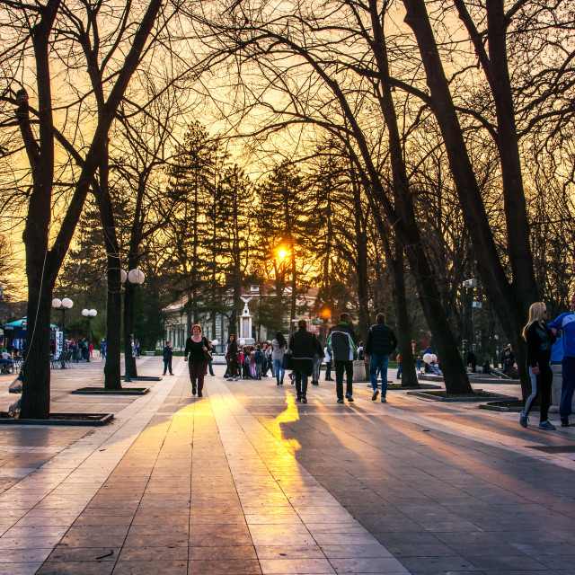 """SOKOBANJA, SERBIA - Sokobanja, Serbia spa city with tourists and locals in the walking area at sunset"" stock image"