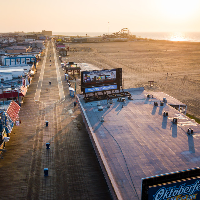 """WILDWOOD, NEW JERSEY, USA - Empty Wildwood boardwalk and beach at sunrise, shoot with a drone"" stock image"