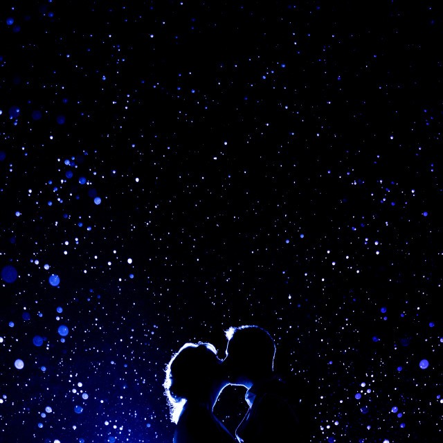 """Couple Kissing In Backlit Blue Rain"" stock image"