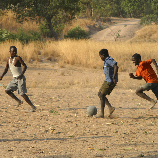 """football, soccer, football in Africa. Young boys playing football, soccer in..."" stock image"