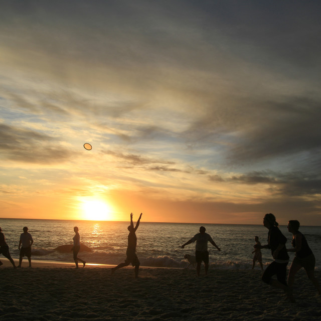 """frisbee players on Clifton Beach at sunset, Cape Town, South Africa. 09-21-2009"" stock image"