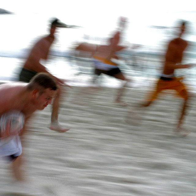 """Playing rugby on Clifton Beach, in Cape Town, South Africa. May 19, 2003."" stock image"