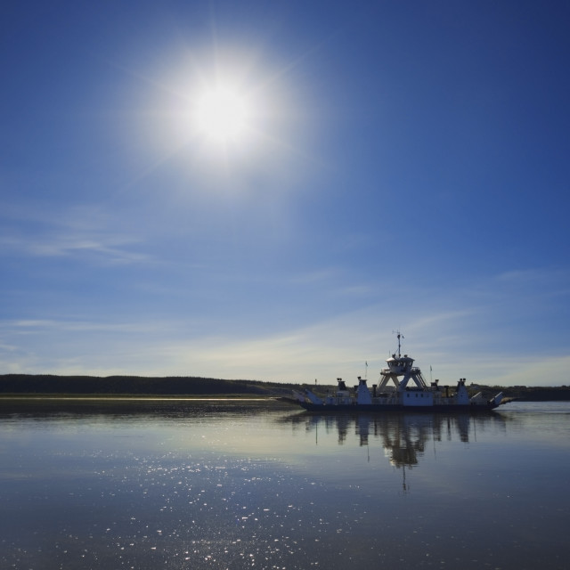 """Northwest Territories, Canada; Ferry Crossing The Mackenzie River"" stock image"