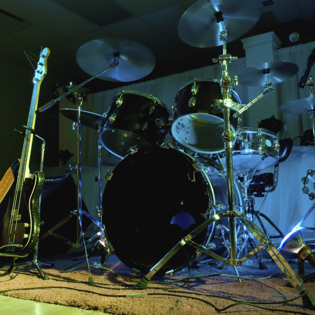"""A Drum Kit And Electric Guitar Set Up For A Band; Bashaw, Alberta, Canada"" stock image"