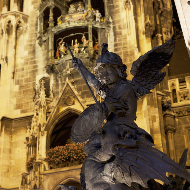 """""""Winged Statue With A Lit City Hall Tower And Glockenspiel In The Background..."""" stock image"""