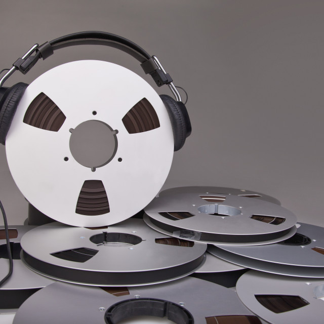 """""""Headphones On A Reel Of Recording Tape"""" stock image"""